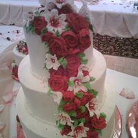First Wedding Cake this was a 12,9,6 wasc with sugar shacks bc with royal icing lilies and roses cascading down.she also ordered a 9,6 and a single 6[they...