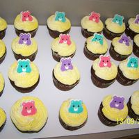 Care Bears here are some chocolate cup cakes with butter cream icing and candie care bear heads.