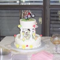Wedding Cake This is my 1st Wedding cake. It was a white cake with butter cream filling and butter cream icing than covered with fondent.The roses are...