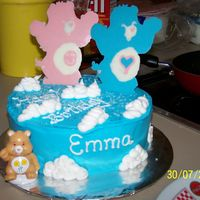 Care Bears marble cake with buttercream icing and the care bears on the top of the cake r chocolate melts.
