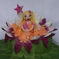 Water Lily Fairy Cake  I made this cake for a customer that asked for a 3D fairy cake and left me to the design. I decided to do a fairy in a water lilly. The...