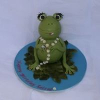 Froggy I made this cake for a 9 year old girl who didn't want it too girly. She also wanted a peace symbol on the cake somewhere, so i gave...
