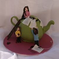 Teapot.jpg  I made this cake for my friend Nati...yes that Nati...the CC legend! I made a cake that was a wee bit soft for the fondant and the whole...