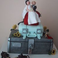 Suitcase Wedding Cake First wedding cake i ever did. Started off as three blue suitcases and progressed into a tool box, blue suitcase, red vanity bag, bride and...