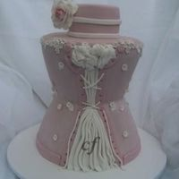 Corset Wedding Cake  Made with 5 cake dummies and sculpted. This was a practice cake i made for a bridal show. If i did it again i would sculpt it more in the...
