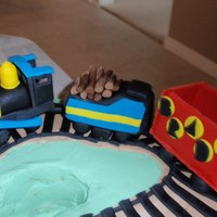 Fondant Train Train on my 2 year old's birthday cake. Made completely of fondant