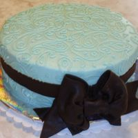 Paisley Bridal Shower This was for a bridal shower. The bride's colors were Aqua and Brown. Cake is covered in buttercream. The bow and ribbon is dark...