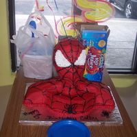 "Spiderman Spiderman cake for my sons 5th birthday! The head is a styrofoam ""wig"" head. All covered in red buttercream."