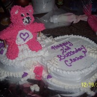 "Pink Care Bear Care Bear is made out of rice krispy treats. ""cloud"" is 2 round cakes side by side. This cake isn't exactly how I hoped it..."