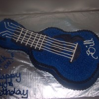Black And Blue Guitar guitar made from the wilton shaped pan. frosted in buttercream