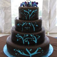 Blue Cut-Put This cake weighed about 125 lbs! It is 4 tiers, each tier being a different cake. Blue layer of fondant colored to match bridesmaids...