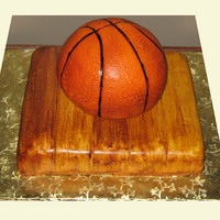 Basketball Cake Fondant covered basketball and floorboards for a groom's cake