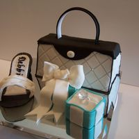 Diamond For A Birthday Girl I had so much fun doing the tiffany ring box, the gumpaste shoe, a challenge, the purse was fun to. Purse cake was nicholas lodge inspired...