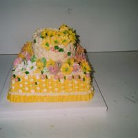 "Wilton Class Iii - Graduation Cake This cake is a 2- 12"" layer and 2- 7"" layer with buttercream and royal icing for the flowers. When I brought this cake home, my..."