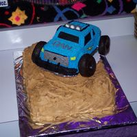 Monster Truck Birthday Cake  The idea is from an old Wilton yearbook. Made with the 3-D cruiser pan, with a 11x14 base, with mini wonder pan hills. My godson picked it...