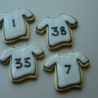 Soccer Jersey Cookies The team uniforms were silver with black trim, so I iced them in black and grey, then dry brushed with a tiny bit of silver luster dust....