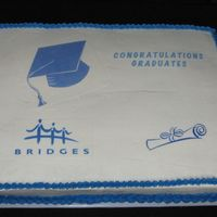 Ged Graduation Celebration 18 x 24 - 1/2 vanilla, 1/2 chocolate. Edible images. Crease happened when it was transported.