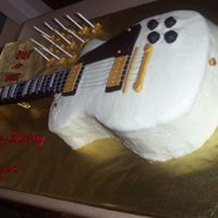My First Attempt At A Guitar Cake Hope I get to do another one, since this one was a learning experience. Neck is rice krispie treats. Should have used royal icing under the...