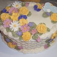 Wilton Course 2 Whoa! I had a lot of flowers to work with! Maybe too many for this cake. First time doing basket weave and making royal icing flowers and...
