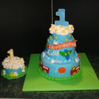 "Caseys First 9/6/4 "" carrot cake filled with cream cheese frosting covered in a cream cheese buttercream with fondant accents- 4"" smash cake..."
