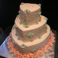 "Steph Hearts wedding - 14""-10"" and 6 "" yellow cake, torted and filled w/ BC.colors to brides specifiications. BC with ""s&quot..."