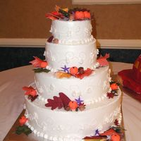 Fall 16/12/8/6 inch marble cake with bc filling bc frosting and gumpaste fall leaves,acorns,pumpins
