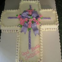 "Jess Communion chocolate 12 X18 "" carved to cross- filled w/ strawberry Bc. Covered in bc with gumpaste pearls,bow,roses"