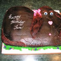 "Janie puppy carved from 12 X18"" chocolate cake. covered in bc and airbrushed brown- gumpaste boe and mmf eyes and nose"