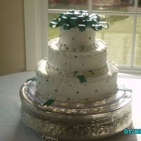 My First Fondant Bow 3 tier cake with lemon poppyseed, coconut, and white chocolate layers with champagne filling. Handmade fondant beading, and my first...