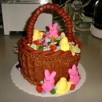 Easter Basket   Cake was iced in buttercream. Handle made out of fondant (Which gave me the serious problems!!!)
