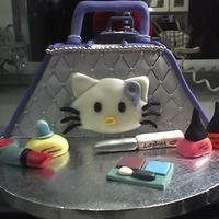 Hello Kitty Purse  I made this cake for my daughter's 9th b-day. (She's a BIG Hello Kitty fan, if you can't tell!) The handle and all the...