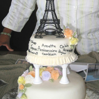 Summer In Paris  Cake for winner of a trip to Paris. Fondant covered two-layer filled cakes with pastel fondant roses topped with a metal Eiffel Tower;...