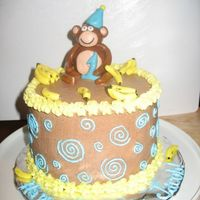 Monkey Smash Cake   Banana cake with chocolate buttercream filling and frosting for first birthday party. Fondant monkey and bananas.