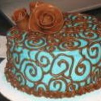 Turquoise And Brown   Chocolate cake, cookies and cream filling, Tootsie Roll roses (love them!).