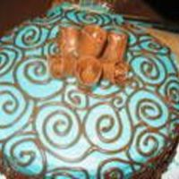 Turquoise And Brown Snickerdoodle cake, turquoise frosting with brown scrollwork, tootsie roll roses (LOVE THEM!).