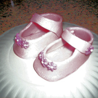 Baby Girl Shoes & Onsies My 1st time making these, was a lot of fun. I used 50/50 gum paste & fondant