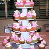 Cupcake Tower Embellished with white chocolate baby bottles, bibs, cribs & blocks on top