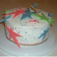 Star Birthday Cake My 15 yr. old wanted a cake with ehr favorite design...STARS! The icing is buttercream, with watered down buttercream splattered on it. The...