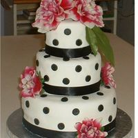 Polka Dot Graduation Cake I made this cake for my niece's graduation party. It was my FIRST TIME using MMF from the recipe from this site! I always HATED the...