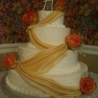 Fall Wedding   four tier, lemon, chocolate, and white cakes...buttercream iced, fondant drapes