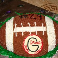 Football another football cake I made my first batch of buttercream tonite ( lemon flavor w/ 2tsp of coco powder)
