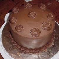 Chocolate, Chocolate And More Chocolate!! I made 3 - 8 inch layers ( full) of Cake Mix Doctor's Darn Good Chocolate cake and filled and iced with buttercream. I used wax paper...