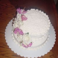 Practice Cake For Course 1 Since I have just started the Wilton 1 class, I haven't learned how to make flowers yet so I just used some leftovers from my daughter...