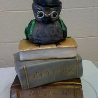 Owl And Books cake done for my first pta funtion at my daughters elementary school. humidity was a killer, and the cake started drooping. my little owl...