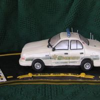 Sheriff's Car Before Touchups (Done Onsite)  first car cake i've done, so i've now learned i need to charge far more, or work much faster!! i always take a pic with the flash...