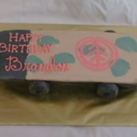 Skateboard Cake   Two layers of cake carved into a skateboard. I used oreos covered with black fondant for the wheels.