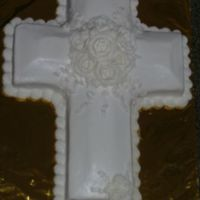 First Communion Cross I made this for 3 children taking their first communion. The 3 small roses at the bottom of the cross are for them. The photo was difficult...