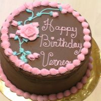 Chocolate And Pink Birthday Cake Chocolate cake with chocolate fudge filling. Pink BC border and flowers.TFL.