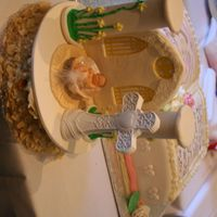 My Daughter Baptism Cake The cake topper is made out of fondant and sugarpaste. The baby in a shell is a ceramic cake topper purchased at a local store. The cake...