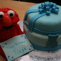 Tiago 1St Birthday Cake This cake was made for my nephew who turned 1years old and loves Elmo. Elmo is made out of fondant. Cake is Chocolate and Vanilla with...